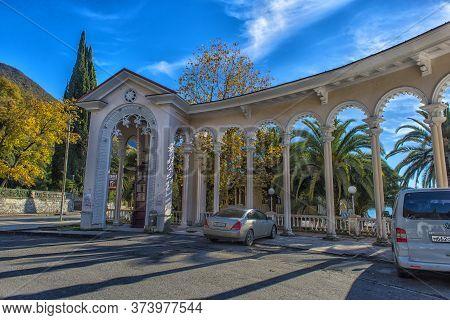 Gagra, Abkhazia, 01.12.2017  Arch Of Colonnade In Gagra, Abkhazia, Backlit Against The Sky,