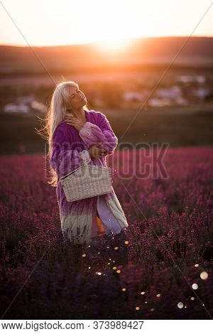 Beautiful Elegant Blonde Woman 24-25 Year Old Wearing Stylish Knitted Cardigan Posing In Lavender Fi