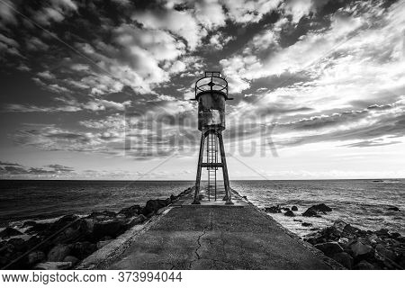 Jetty And Lighthouse In Saint-pierre, La Reunion Island