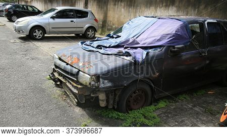 Salvador, Bahia / Brazil - June 29, 2020: Abandoned And Completely Destroyed Vehicle Is Seen In A Re
