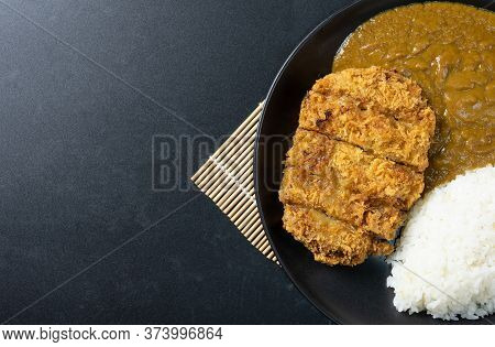 Tonkatsu Curry Rice (japanese Deep-fried Pork Cutlet With Curry Rice). Top View On Black Background