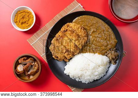 Tonkatsu Curry Rice (japanese Deep-fried Pork Cutlet With Curry Rice) Served With Karaage (japanese