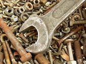 Assortment of rusty metal fasteners and two wrenches. Background for any using in design poster