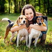 beautiful woman and his dogs posing outside poster