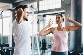 Sport Couple Stretching Muscle Before Sport Activity In Fitness Gym Club