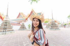 Beautiful Asian Tourist Backpack Women Walking Travel In Buddhistm Temple Pagoda Statue