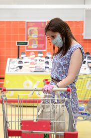 Woman Wears Protective Mask And Gloves While Shopping At Supermarket. Pandemic Times Shopping.
