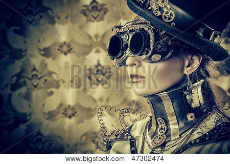 Portrait of a beautiful steampunk woman over vintage background.