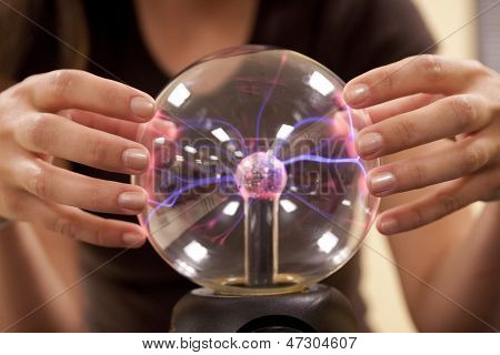 Female Student Touching A Plasma Ball.