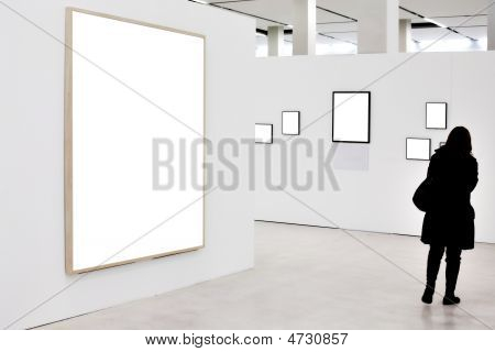 Walls in museum with empty frames and person move poster