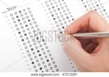 Teacher correct the test (questionnaire). Top view. poster