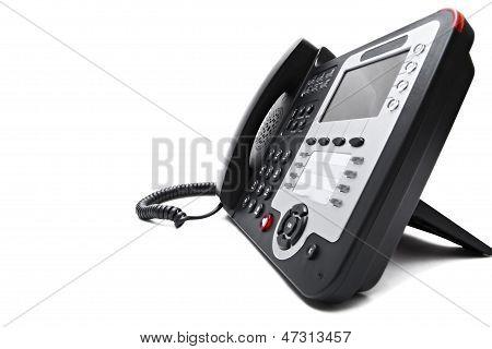 Black IP phone close up isolated on white background