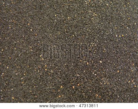 black sand with colored dots