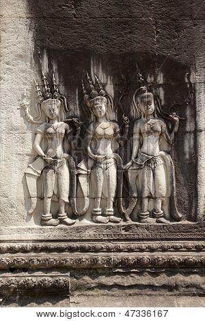 Bas-relief of dancing girls Apsara. Angkor Wat, the Kingdom of
