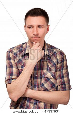 Pensive man in plaid shirt