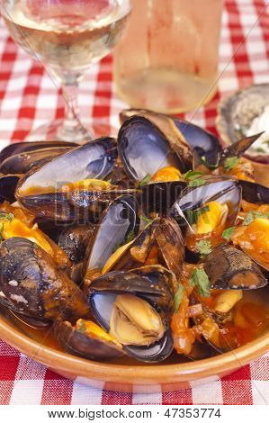 Steamed Mussels With Marinara Sauce And A Glass Of Wine