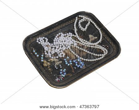 an old  tray with beads and jewelry