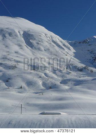 Ski lines run down a well traversed slope Andermat, Switzerland