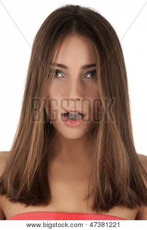 Beautiful girl hold ice cube in mouth and eat it