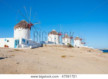 Windmills On A Hill Near The Sea On The Island Of Mykonos