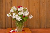 bouquet of white flowers and red roses on the ragged old wooden wall background poster