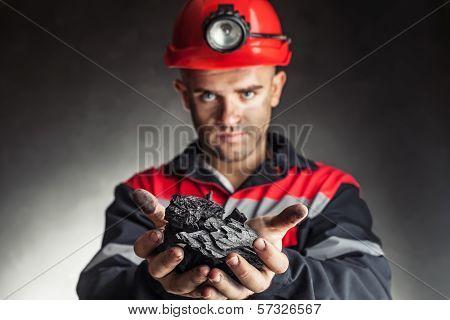 Coalminer Holding Lump Of Coal
