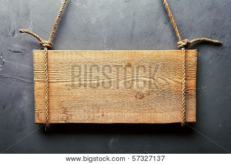Wooden Signboard Hanging On Rope