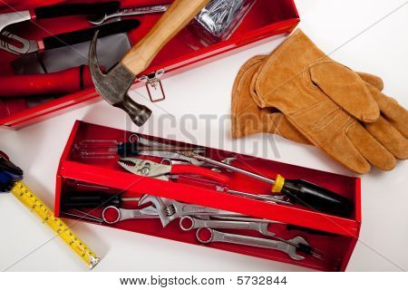 A Red Toolbox With Miscellaneous Tools