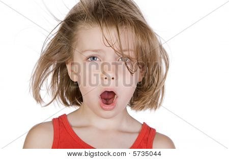 Shot Of A Cute Child With Windswept Hair