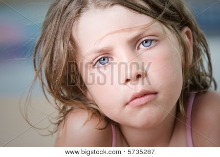 Close Up Shot Of A Beautiful Young Child With Wind Swept Hair