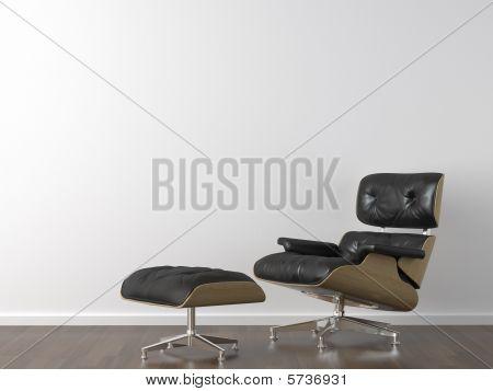 Fekete bőr fotel, a fehér fal