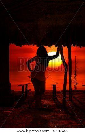 Woman At Dark Sunset