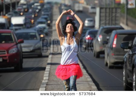Girl In Pink Skirt Goes On Highway Middle