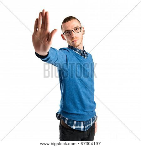 Young Man Doing Stop Sign Over White Background