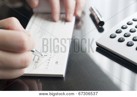 Business woman prepare writing a check