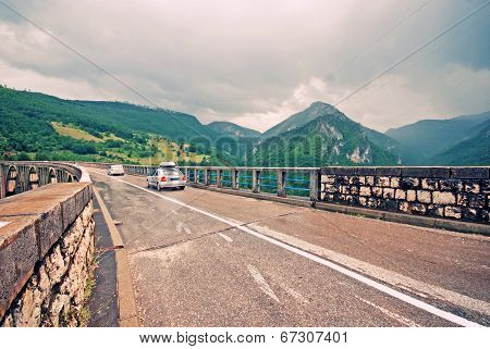 Car Crossing Bridge Over Tara River, Montenegro