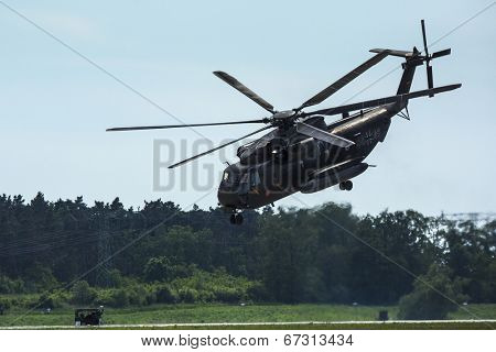 BERLIN, GERMANY - MAY 21, 2014: Sikorsky CH-53 Sea Stallion is the heavy-lift transport helicopter, demonstration during the International Aerospace Exhibition ILA Berlin Air Show.