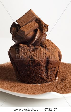 Chocolate Muffin On White Plate With Cocoa Powder