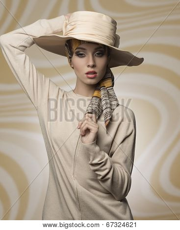 charming woman wearing elegant coordinated beige hat and dress in fashion pose looking in camera poster