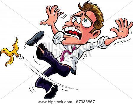 Cartoon businessman slipping on a banana peel.