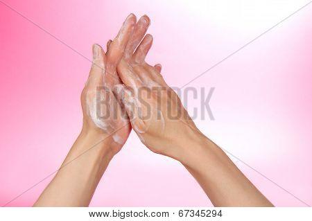 Hands in the foam of soap