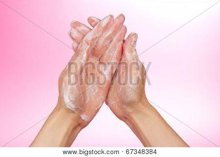 Foam of soap on female hands