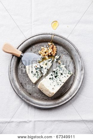Dor Blue Cheese With Honey And Nuts On Plate