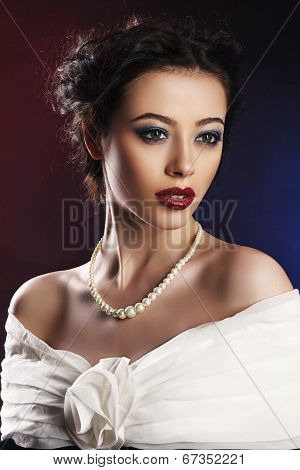 beautiful woman with makeup wearing evening dress
