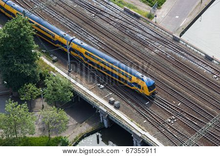 Aerial view of a Dutch train leaving the station Holland Spoor