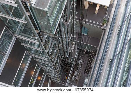Looking Downwards In A Modern Open Elevator Shaft
