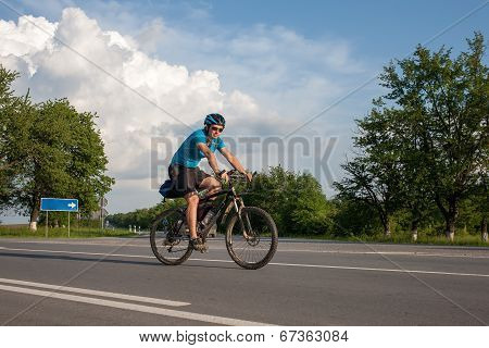 Man Cycling At The Road