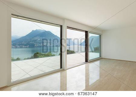 Interior, modern penthouse, empty living room with large windows