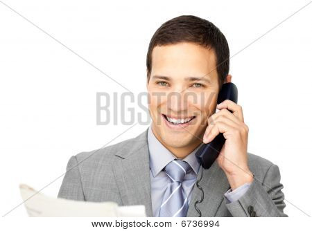 Attractive Businessman On Phone Holding A Newspaper