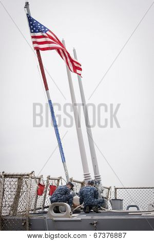 STATEN ISLAND, NY - MAY 21: The American flag flies from the stern of the guided-missile destroyer USS McFaul (DDG 074) docked at Sullivans Piers during Fleet Week NY on May 21, 2014.